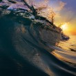 Surfing tropical design template. Green blue colored ocean wave breaking and splashing at sunset time — Stock Photo #24325015