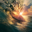 Sunset on the beach with screw ocean wave — Stock Photo #24325067