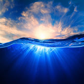 Design template with underwater part and sunset skylight splitte — Stock Photo