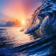 Sunset on the beach with screw ocean wave — Stock Photo #31457997
