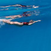 Professional female swimming — Stock Photo