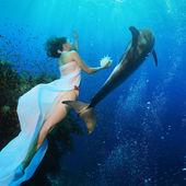Beautiful mermaid with wild dolphin — Stock Photo