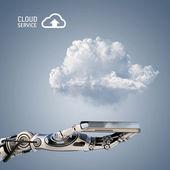 Robot arm holding smartphone — Stock Photo