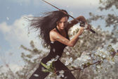 Beautiful Brunette with katana sword — Stock Photo