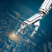 Robot hand working with circuit board — Stock Photo