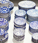 Blue and white pottery plate for sale — Stockfoto