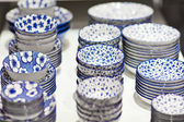 Blue and white pottery plate for sale — Stok fotoğraf
