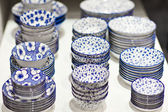 Blue and white pottery plate for sale — Stock fotografie