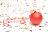 Christmas bauble and stars — Stock Photo