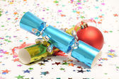 Christmas Cracker and Christmas Bauble — Stock Photo