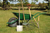 Wheelbarrow and tools — Stock Photo