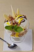 Delicious ice cream with fruits — Stock Photo