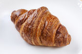Appetizing croissant on a plate — Stock Photo