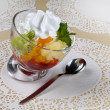 Fruit dessert with cream - Stock Photo