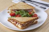 Sandiwch with tomatos on plate — Stock Photo