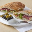 Stock Photo: Sandwich with bacon and olives