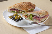 Sandwich with bacon and olives — Stock Photo