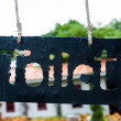 Toilet sign on the metal plate hanging in the park or garden — ストック写真