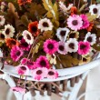 Stock Photo: beautiful colors of artificial plastic small flowers in pot