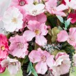 Beautiful colors of artificial plastic small flowers in pot — Stock Photo