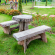 The empty wooden table and bench in garden or park — Stock Photo