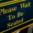 Stock Photo: Please Wait To Be Seated Sign
