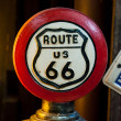Red Circular of Route 66 Sign (orange light from left side) — Stock Photo
