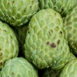 Fresh organic custard apples for sale at a market — Stock Photo