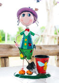 Cute smile doll with a beautiful basket on dining table — Stock Photo