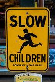 Yellow Slow Children street sign — Stock Photo