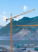 Cranes at a construction site in mountain area — Stock Photo