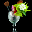 Wine crystal glass with brushes and makeup cosmetics isolated on black - set of cosmetics in crystal glass — Stock Photo