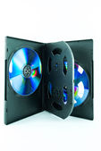 Black Case for DVD Or CD Disk with DVD Or CD Disk isolated on white background - the CD in the package - Black compact disk — Stock Photo
