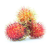 Rambutan is a fruit with sweet red shell - Fresh rambutan sweet delicious fruit - Rambutan fruit isolated on white background — Stock Photo