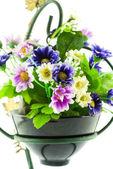 Decorativas flores artificiales en maceta aisladas en blanco — Foto de Stock