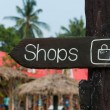 Wooden signage indicating shopping area to the market — Stock Photo