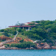 Stock Photo: Island in sewith small house