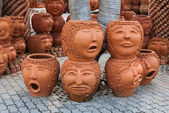 PATTAYA, THAILAND - November 10: The strange pots sculpture look like human face in Nong Nooch tropical garden on November 10, 2010 in Pattaya, Thailand. More than 2000 visitors daily — Stock Photo