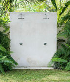 Outdoor shower at swimming pool between the nature — Stock Photo