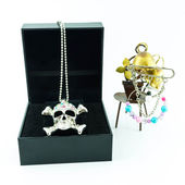 Ring of skull jewelry in jewelry box on white background — Stock Photo