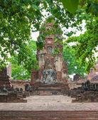 Buddha Statue with leaves foreground - Ayutthaya, Thailand — Stock Photo