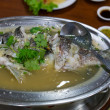 Sour and spicy steamed sea bass fish — Stock Photo