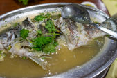 Sour and spicy steamed sea bass fish — Stockfoto