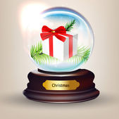 Snowglobe With gift against a bright defocused background with glittering lights and snowflakes for Christmas design. — Stock Vector