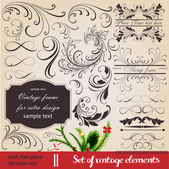 Vector set: calligraphic vintage design elements and page decoration - lots of useful elements to embellish your layout. With snowflake and other christmas and New Year elements. — Stock Vector