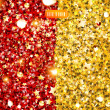 Golden and red glittering background with stars and beads - Stockvectorbeeld