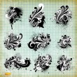 Stock Vector: Vector set: swirls - variety of handdrawn floral design elements