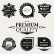 Royalty-Free Stock Vector Image: Vintage Styled Premium Quality and Satisfaction Guarantee Label collection with black grungy design, paper texture.