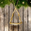 Golden Christmas tree at the old wood background for Xmas card design - Stock Vector