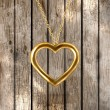 Golden heart at the chain for Valentines day design — Stock Vector